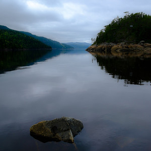 Early morning calm at the Qaui du Petit Saguenay at high tide..